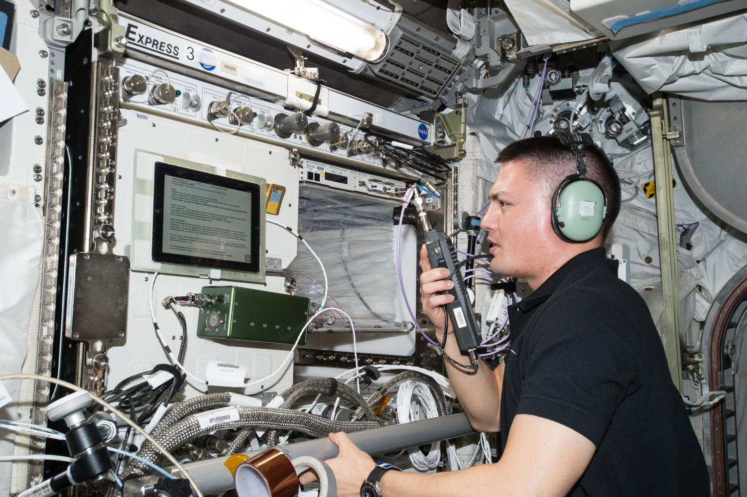 Astronaut Kjell Lindgren uses amateur radio onboard the ISS