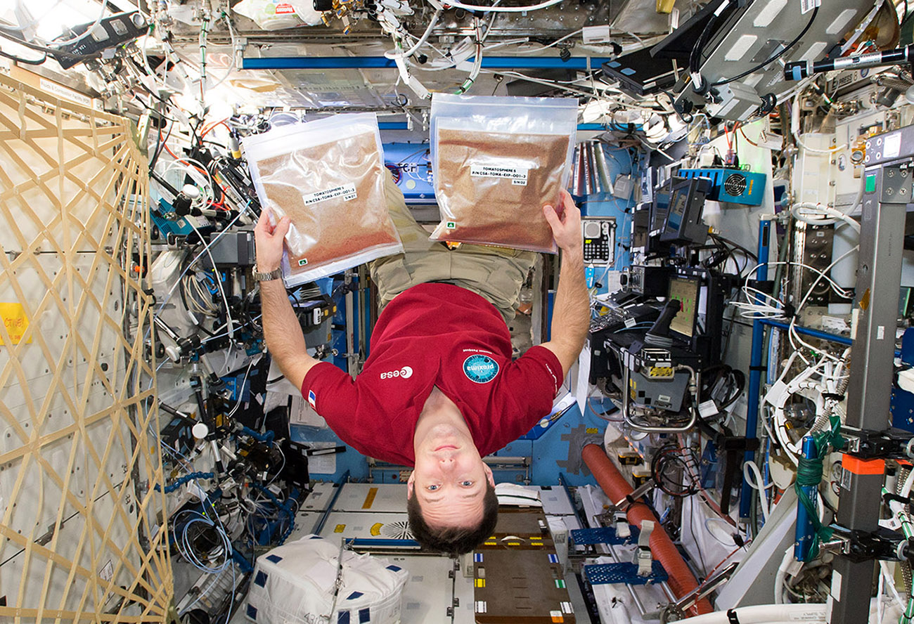 ESA astronaut Thomas Pesquet with Tomatosphere seeds