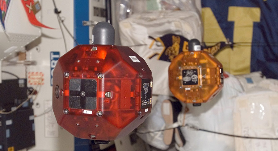 The SPHERES robots on the International Space Station carry out experiments and student competitions