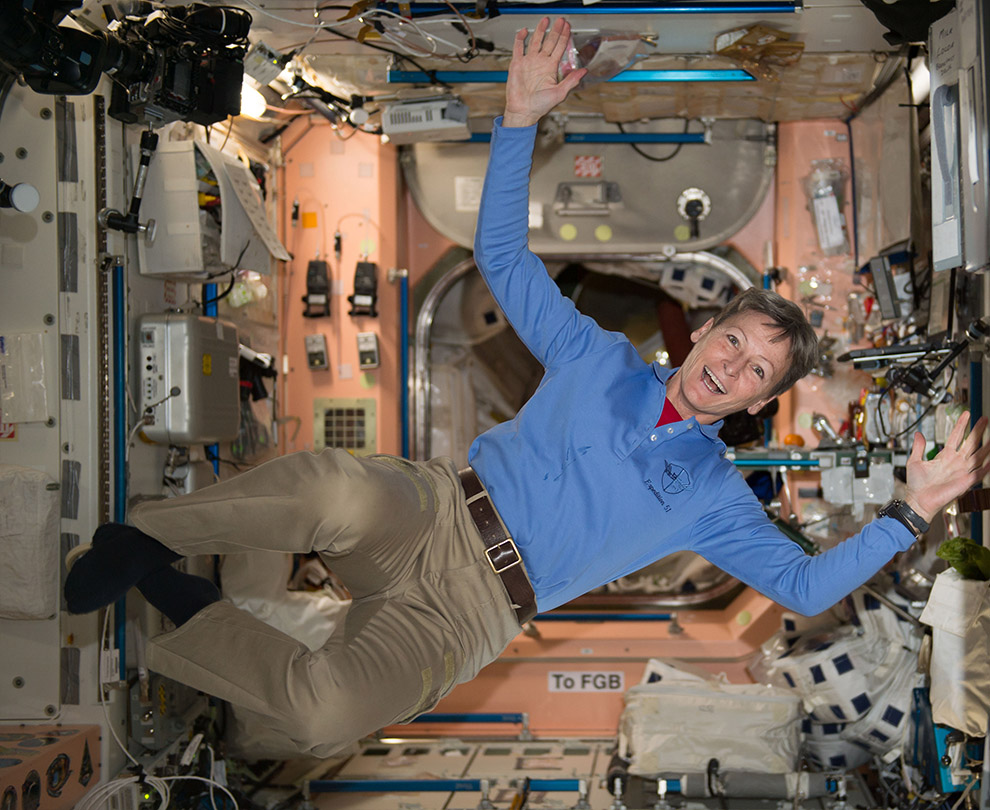 peggy whitson stretching out ISS